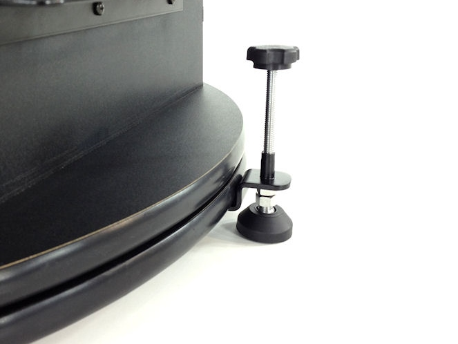 Side view of black leveling pad attached to a machine.