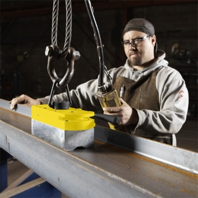 A photo of an industrial worker using Magswitch magnetic lifting tool.