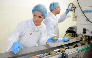 Man using industial components on a food production line